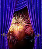 Celebration night. Fireworks seen through windows with violet curtain royalty free stock images