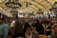 Celebration at the Oktoberfest inside a bavarian tent Royalty Free Stock Photos