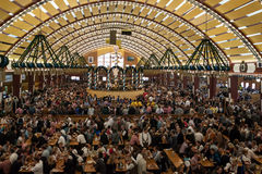 Celebration at the Oktoberfest inside a bavarian tent Royalty Free Stock Images