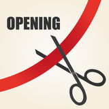 Celebration of opening something with scissors and ribbon Royalty Free Stock Photo