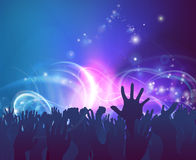 Celebration Party. Crowd background of peoples hands up in celebration in silhouette with abstract lights background Royalty Free Stock Image