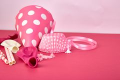 Party pink paper hat. Celebration. Party pink hat polka dot background. Birthday paper hat, candles, tubes and balloons royalty free stock photos