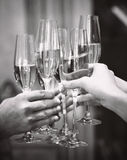 Celebration. People holding glasses of champagne making a toast. Stock Photo