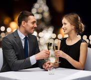 Couple with non alcoholic champagne at christmas Stock Photos