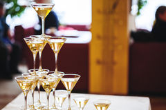 Celebration. Pyramid of champagne glasses. Royalty Free Stock Photo