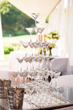 Celebration. Pyramid of champagne glasses. Gently toned. Stock Photos