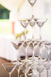 Celebration. Pyramid of champagne glasses. Gently toned. Royalty Free Stock Photography