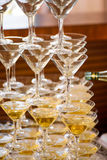 Celebration. Pyramid of champagne glasses. Gently toned. Royalty Free Stock Photos