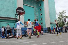 Russia, Murmansk-June 24, 2018: celebration of Russian youth Day, boys play street basketball stock image
