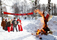 Celebration of Shrovetide. In russian village with burn scarecrow Royalty Free Stock Image