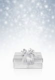 Celebration silver gift box for decoration on snow background Royalty Free Stock Photos