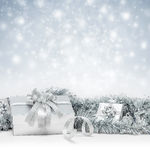 Celebration silver gift boxes on sparkle winter snow background Royalty Free Stock Photography