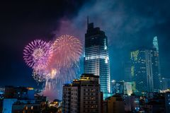 Ho Chi Minh City, Vietnam,february 4, 2019: Lunar New Year celebration. Skyline with fireworks light up sky over business district royalty free stock photos