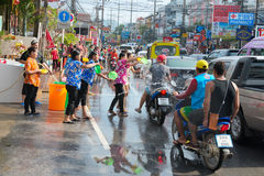 Celebration of Songkran Festival, the Thai New Year on Phuket. Phuket, Thailand - April 13, 2014: Tourist and residents celebrate Songkran Festival, the Thai New stock image