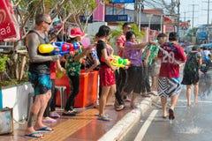 Celebration of Songkran Festival, the Thai New Year on Phuket. Phuket, Thailand - April 13, 2014: Tourist and residents celebrate Songkran Festival, the Thai New Royalty Free Stock Images