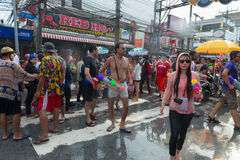 Celebration of Songkran Festival, the Thai New Year on Phuket. Phuket, Thailand - April 13, 2014: Tourist and residents celebrate Songkran Festival, the Thai New stock images