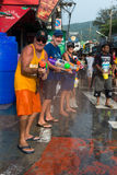 Celebration of Songkran Festival, the Thai New Year on Phuket. Phuket, Thailand - April 13, 2014: Tourists celebrate Songkran Festival, the Thai New Year by royalty free stock image