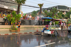 Celebration of Songkran Festival, the Thai New Year on Phuket. Phuket, Thailand - April 13, 2014: Tourists and residents celebrate Songkran Festival, the Thai royalty free stock images