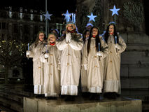 Celebration of St. Lucy's Day in Malmo, Sweden on December 13, 2015. MALMO, SWEDEN - DECEMBER 13, 2015: Lucia and her entourage sing a song on the Main square Royalty Free Stock Photography