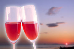 Celebration in the sunset. A romantic celebration in front of a sunset on the beach Royalty Free Stock Image