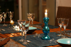 Celebration table. Warm celebration table, focus on candlestick Royalty Free Stock Images