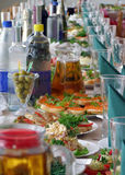 Celebration table. A close-up of banquet - celebration table with many foods, shallow DOF Royalty Free Stock Image