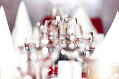 Celebration table decoration with empty glasses stock photos