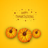 Celebration of Thanksgiving Day with pumpkins and stylish text. Thanksgiving Day celebration with pumpkins and stylish text on yellow background Royalty Free Stock Photos