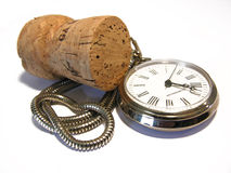 Celebration time. Old pocket watch and cork isolated on a white background royalty free stock images