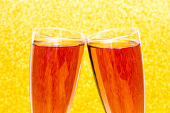 Celebration toast with rose champagne. And golden background Royalty Free Stock Image
