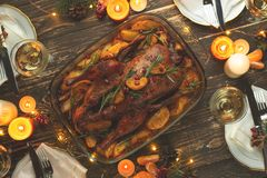 A celebration of the traditional Thanksgiving Day celebration. Flat-lay dinner for the family with roasted duck or chicken on a. Festive Christmas table, top stock photos