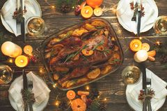 A celebration of the traditional Thanksgiving Day celebration. Flat-lay dinner for the family with roasted duck or chicken on a. Festive Christmas table, top royalty free stock photography