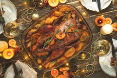A celebration of the traditional Thanksgiving Day celebration. Flat-lay dinner for the family with roasted duck or chicken on a. Festive Christmas table, top royalty free stock photos