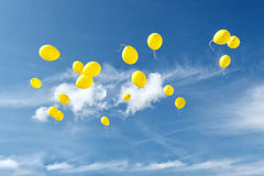 Celebration traditions. Yellow balloons in blue sky. Holiday concept Royalty Free Stock Photos