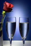 Celebration or Valentine Champaigne. Flute glasses with red rose Royalty Free Stock Photos