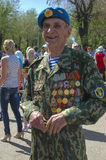 Celebration of Victory Day on May 9, 2012 in Volgograd, Russia. RUSSIA, VOLGOGRAD MAY 9: Old man veteran of WWII in uniform decorated with numerous orders and Stock Photography