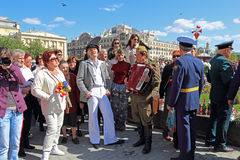 The celebration of Victory Day in Moscow. Unidentified people on the street singing a retro song. Moscow, Russia. The area near the Bolshoi Theater. May 9 Stock Photography