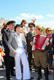 The celebration of Victory Day in Moscow. MOSCOW - MAY 09: The celebration of Victory Day in Moscow. Unidentified people on the street singing a retro song. The Royalty Free Stock Images