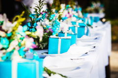 Celebration of wedding. Laid wedding table with gifts and flowers Royalty Free Stock Photography
