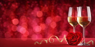 Celebration with wine and rose. Romantic celebration of valentine`s day Stock Images