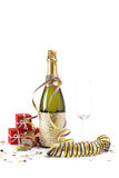 Celebrations. Champagne bottle with empty glass, gisfts, ribbons and confetti for celebrations royalty free stock images