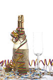 Celebrations kit. Champagne bottle with empty glass, ribbons and confetti for celebrations royalty free stock photography