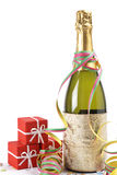 Celebrations kit. Champagne bottle with gifts, ribbons and confetti for celebrations stock photo