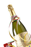 Celebrations kit. Champagne bottle with gifts, ribbons and confetti for celebrations Royalty Free Stock Images