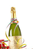 Celebrations kit. Champagne bottle with gifts, ribbons and confetti for celebrations royalty free stock photography
