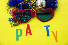 Celebratory accessories for party on a yellow background close-up. Royalty Free Stock Images