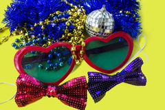 Celebratory accessories for party on a yellow background close-up. Stock Photography
