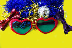 Celebratory accessories for party on a yellow background close-up. Stock Photos