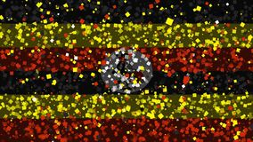 Celebratory animated background of flag of Uganda appear from fireworks. Spirited celebratory fireworks from flat confetti particles with main national colors stock video footage