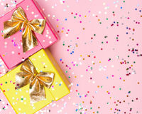 Celebratory background with color gift boxes and confetti Royalty Free Stock Photos